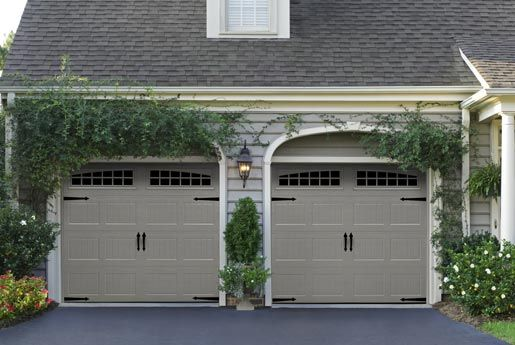 Steel Carriage House Garage Doors Amp Wooden Carriage House Garage Garage Door Styles Garage Door Design Carriage Garage Doors