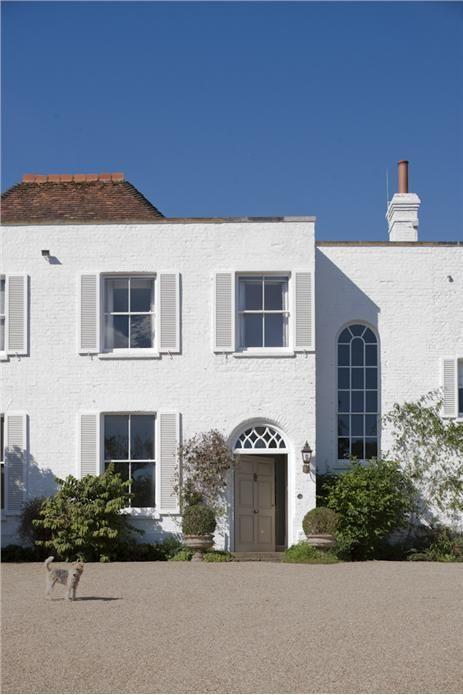 A House With Exterior In Wimborne White Masonry Shutters Eggshell And Door Fawn