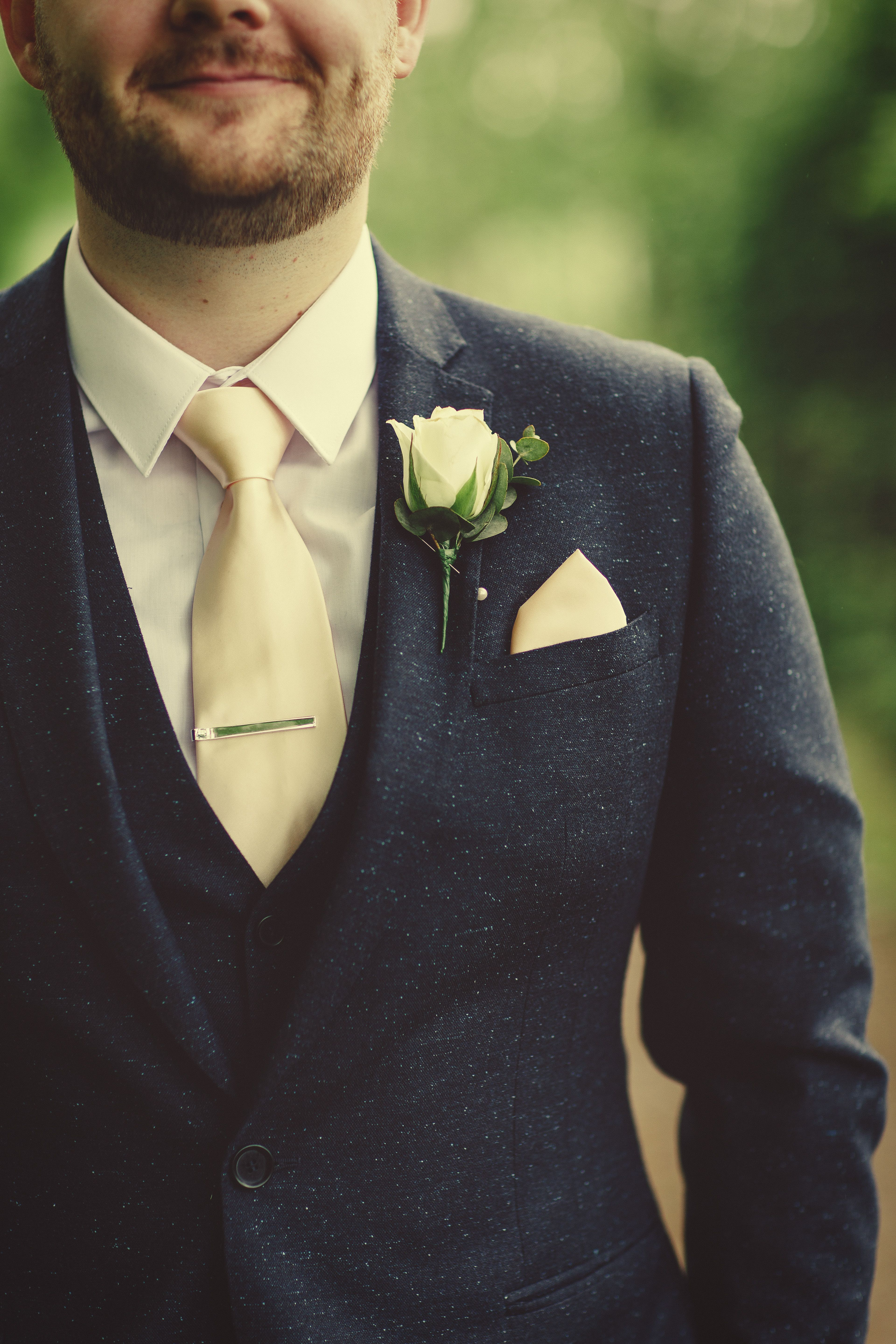 A smart Moss Bros suit and buttonhole created by Green Parlour ...