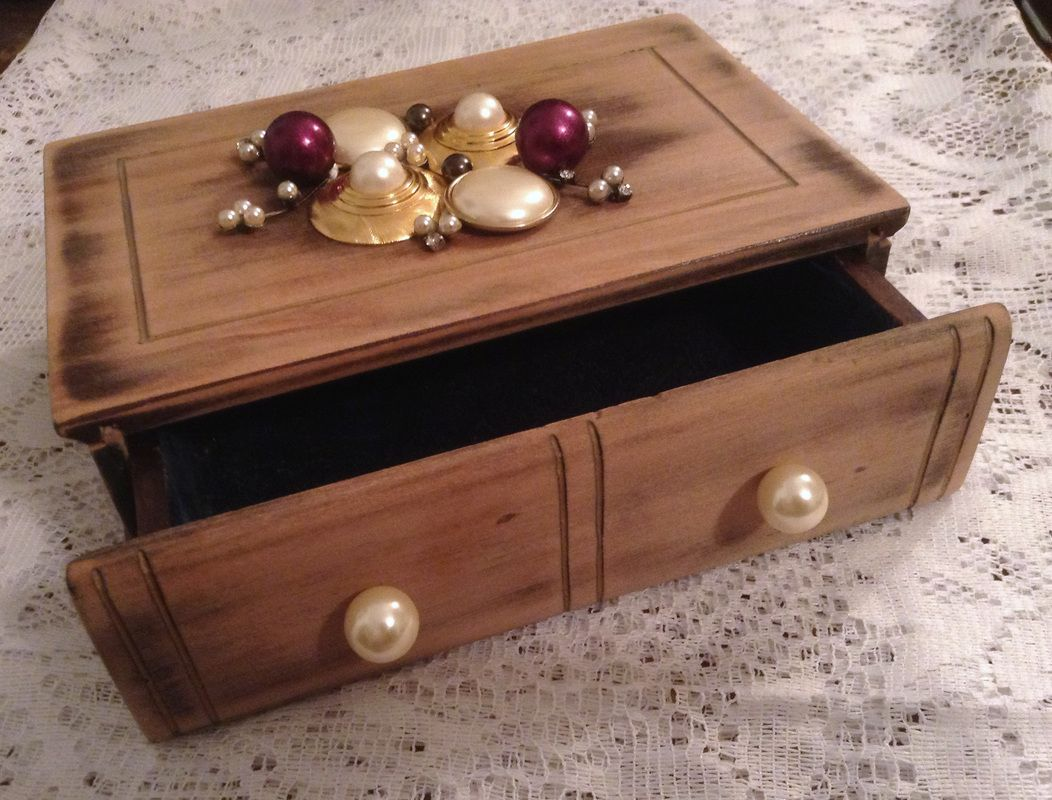 an old jewelry box gets new life from old and broken jewelry