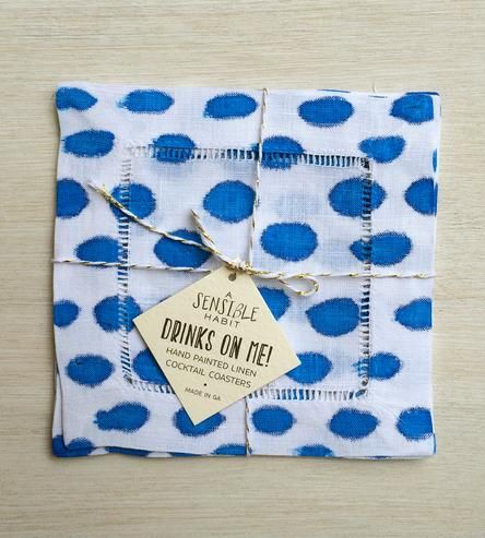 These sprightly painted linen coasters are dual-purpose. First of all, they keep your tabletop protected from coffee mugs, beer mugs and whatever other sorts of mugs you might set down. And secondly, each of the fabric coasters lends an air of whimsy to your tabletop. Each coaster is carefully painted by hand with blue stripes.