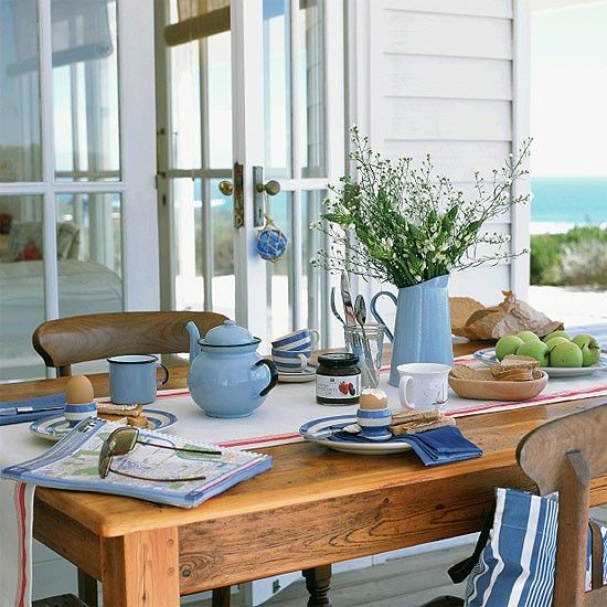 Dining Area With Wooden Table Chairs And Blue White Accessories