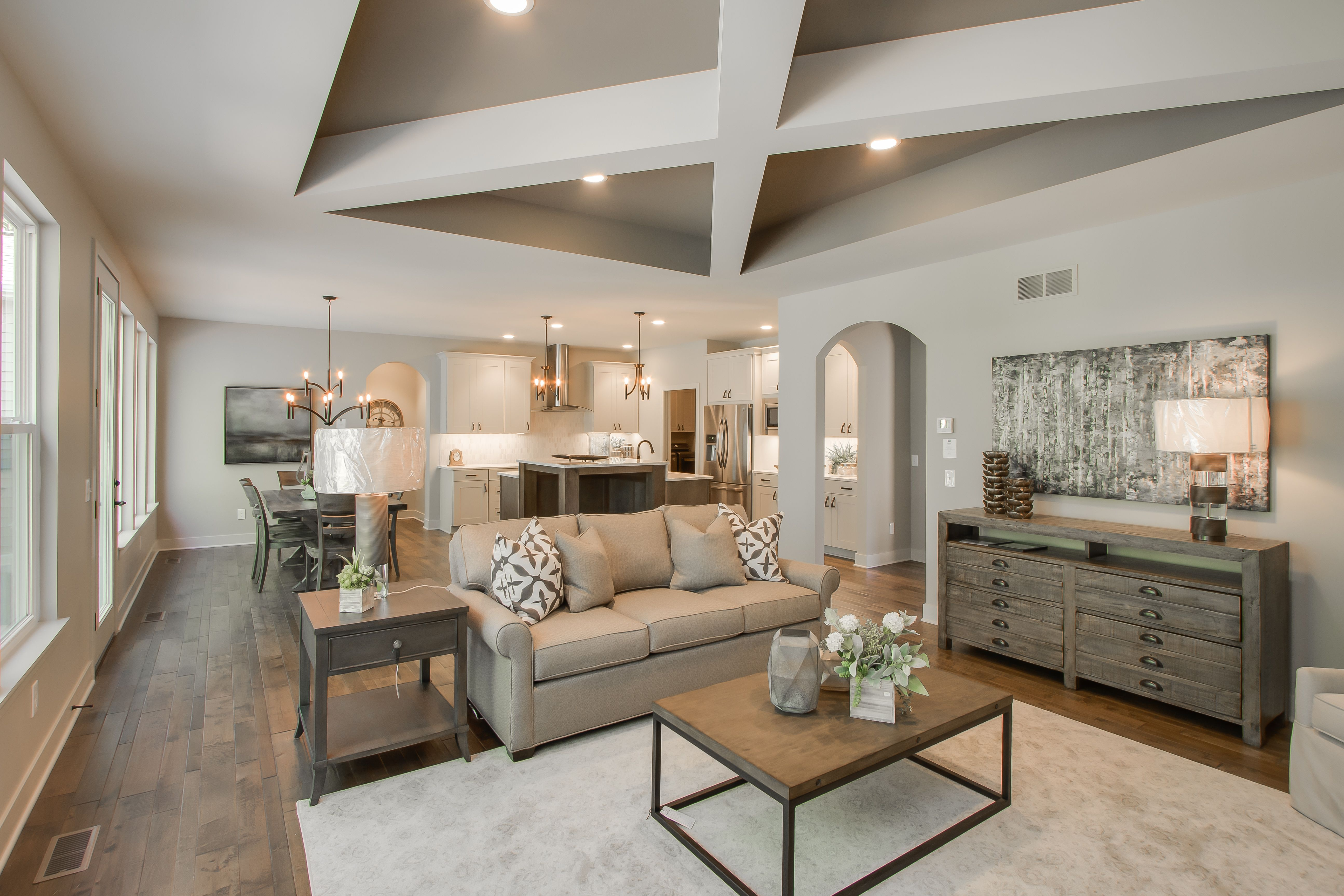 Living Room: Maple hardwood floors, stained mantle, coffer ceiling with box  beam detail