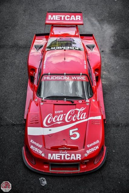 Porsche 935 K3 with Coca-Cola Livery, 1980-1982! Chassis: 000 0013 - This chassis was raced extensively for the better part of six seasons. Its 1980 outings included Le Mans where it failed to finish. For 1981, it was repainted in Jagermeister orange and raced by Bob Wollek in the DRM series to two wins. Bob Akin acquired the car halfway through the season and raced it extensively in Coca Cola colours. In 1982, Akin was partnered in the IMSA series by Derek Bell.