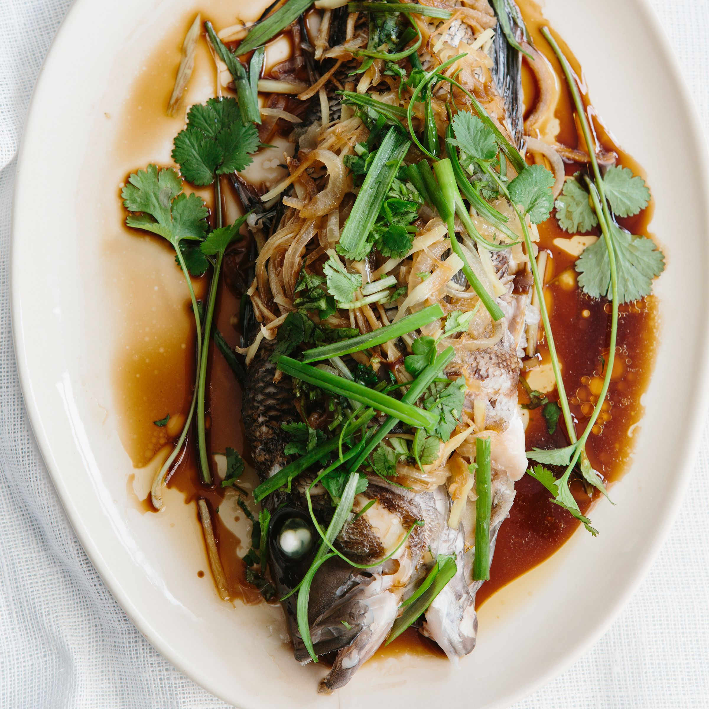 Steamed bass with onion ginger and scallion recipe for Bass fish cooking