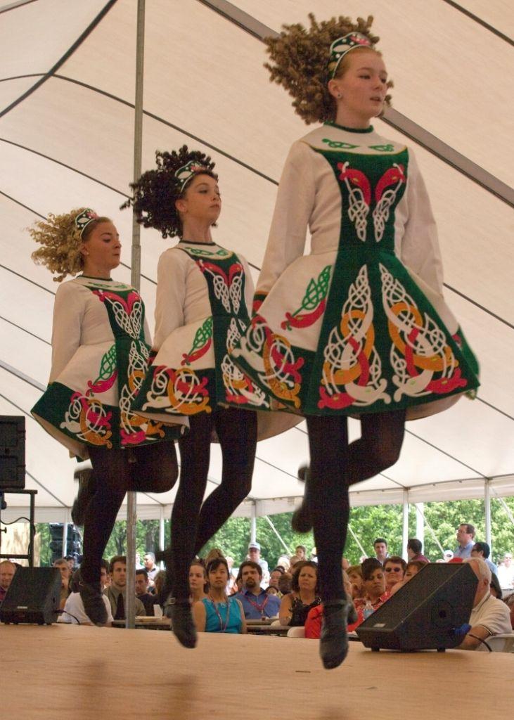 Irish dancers in modern Irish dancing costumes, wearing ...