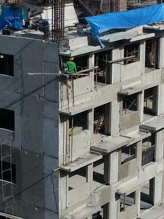 Dude working at the 24th floor. Guy has got to have huge cojones.
