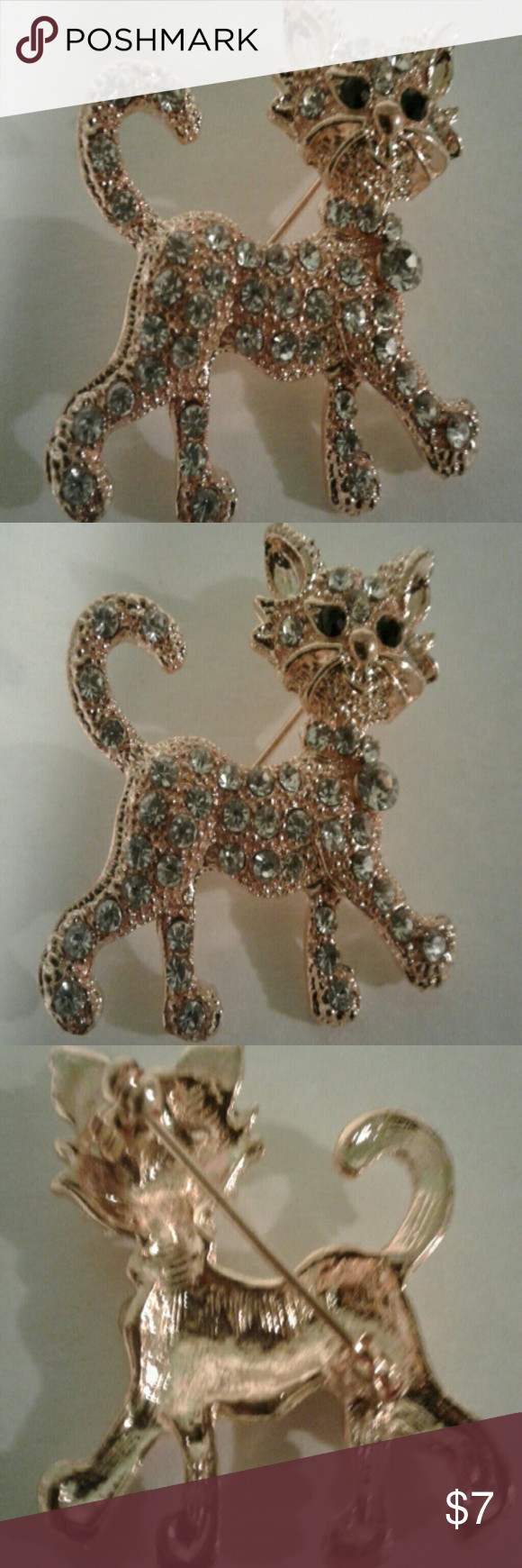 Adorable Gold Tone Crystal Kitty Cat Pin A very pretty piece of costume jewelry for the cat lovers!   This kitty is gold in color and is embellished with crystals and has black jeweled eyes.   Measures approximately 1 1/4 inches tall by 1 1/4 inches wide.   Just the right size to wear on your collar or use to hold a scarf.   I love cats and if I find more than one in a piece, you will find here! unbranded  Jewelry Brooches