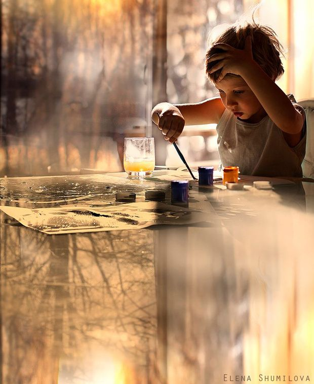 There is so much to this picture that I don't know where to start, the child? the composition? the subject? the reflections? the coloring?  It is just so interesting!