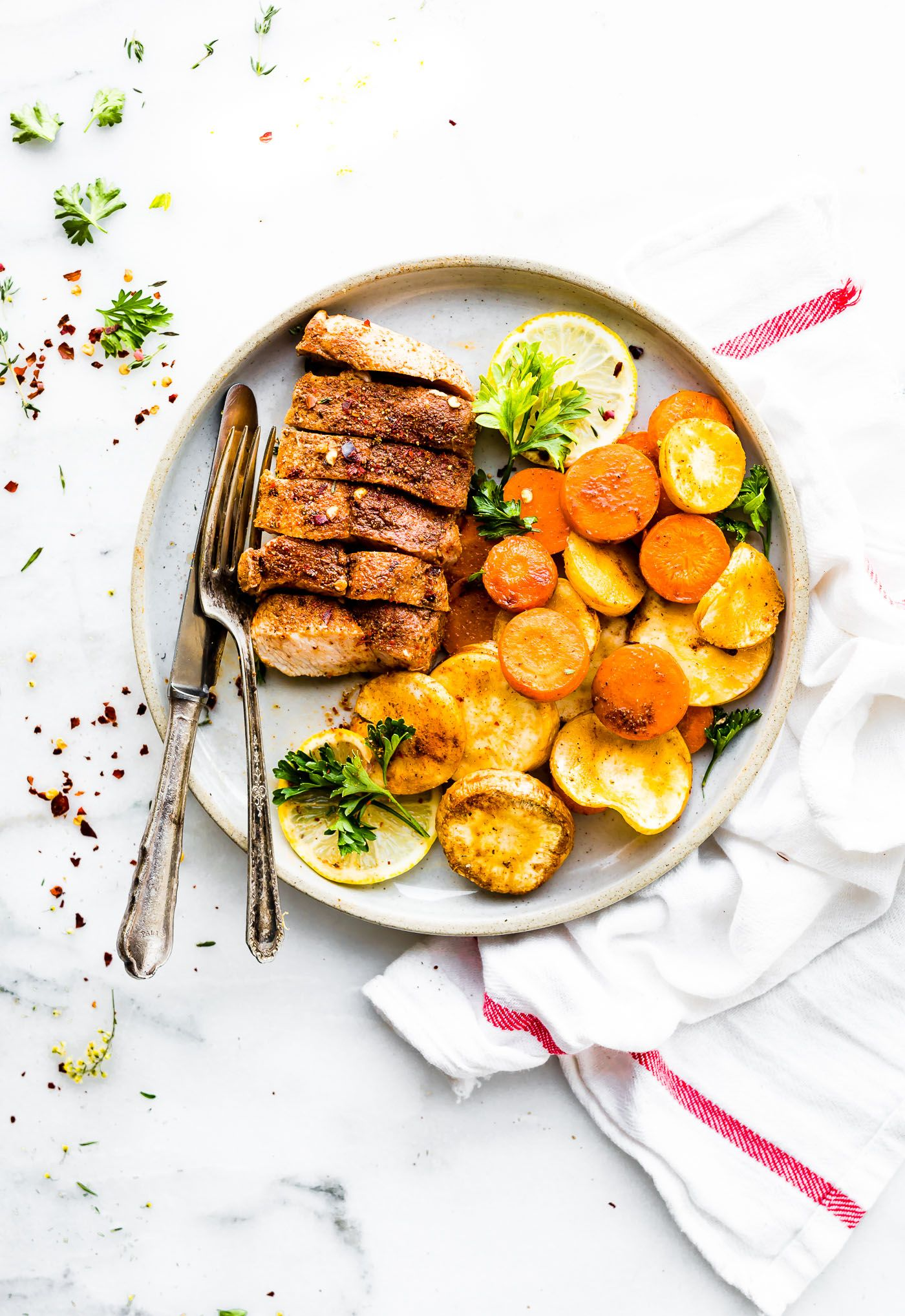 Cinnamon chipotle baked pork chops with parsnips and