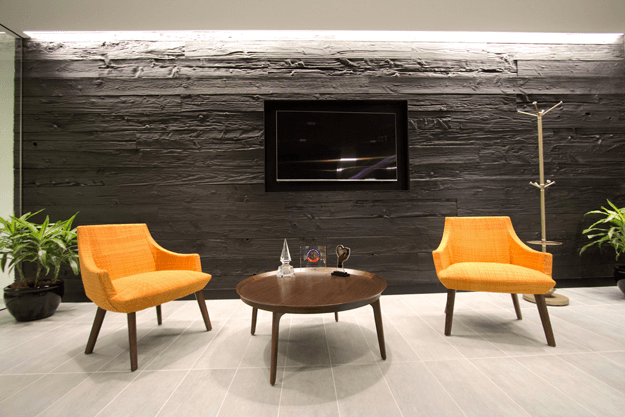 shou sugi ban charred wood accent wall, orange accent chairs