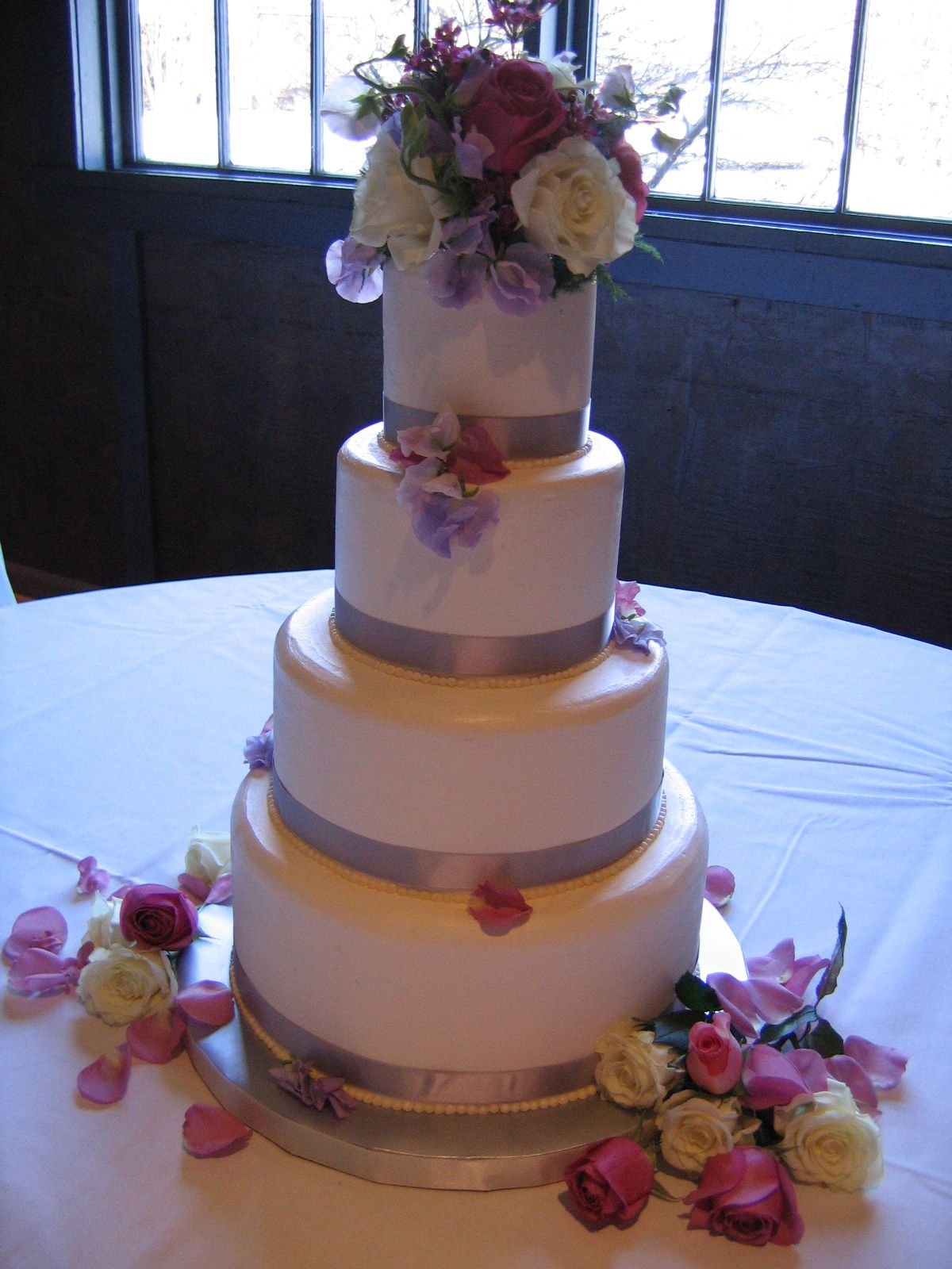 Magpies Bakery Knoxville, TN Four Tier Buttercream Wedding Cake. #wedding  #satin #flowers #love