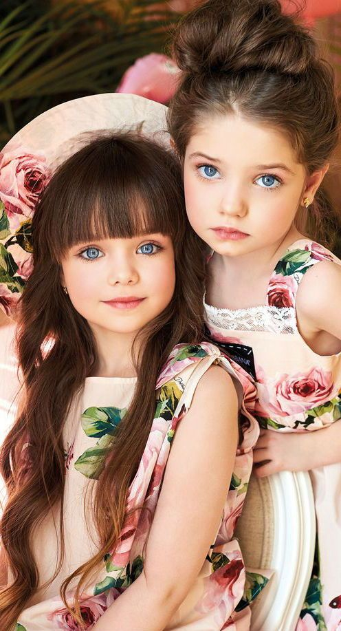 Gorgeous!  Adorable celebrity models wearing Dolce & Gabbana Rose Floral Pattern Pink Christmas in July Dress. Gorgeous Mini Me look inspired by the Dolce & Gabbana Women's Spring Summer 2018 Collection. Instagram post by @anna_knyazeva_officia Maria Gert. Shop Online. Ships Worldwide. #dolcegabbana #celebrity #kidsfashion #fashionkids #girlsdresses #childrensclothing #minime #mommyandme #model
