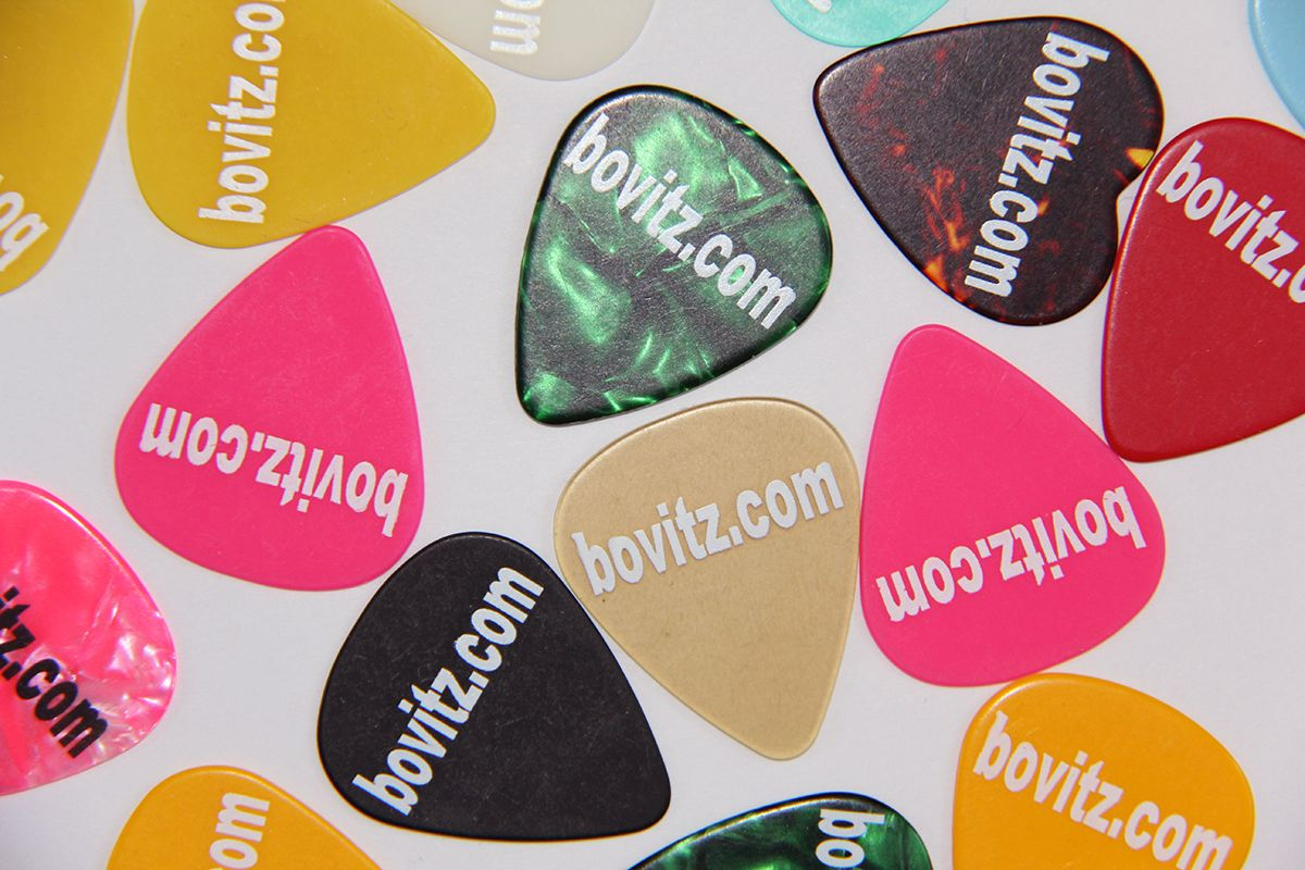 A bankruptcy lawyer and musician hands out custom-made guitar picks ...