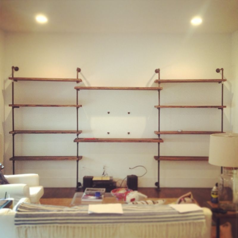 industrial shelving around the tv in the living room this is happening