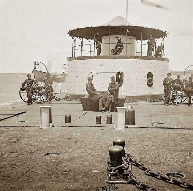 Here for your enjoyment is an inspiring photograph of Charleston Harbor, S.C.  Deck and officers of U.S.S. monitor Catskill; Lieutenant Comdr. Edward Barrett seated on the turret.  It was made in 1865.