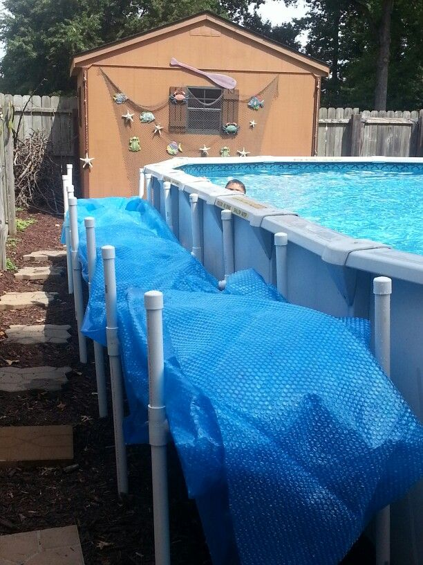 Solar cover holder husband made pool heaters pool - Covering a swimming pool with decking ...