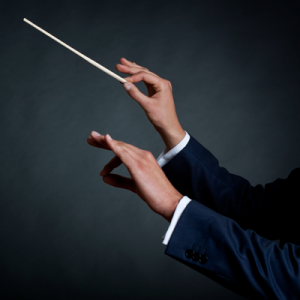 Ed Tech Coaches Are The Orchestra Conductors Of K 12 Education Orchestra Conductor Instructional Coaching Edtech