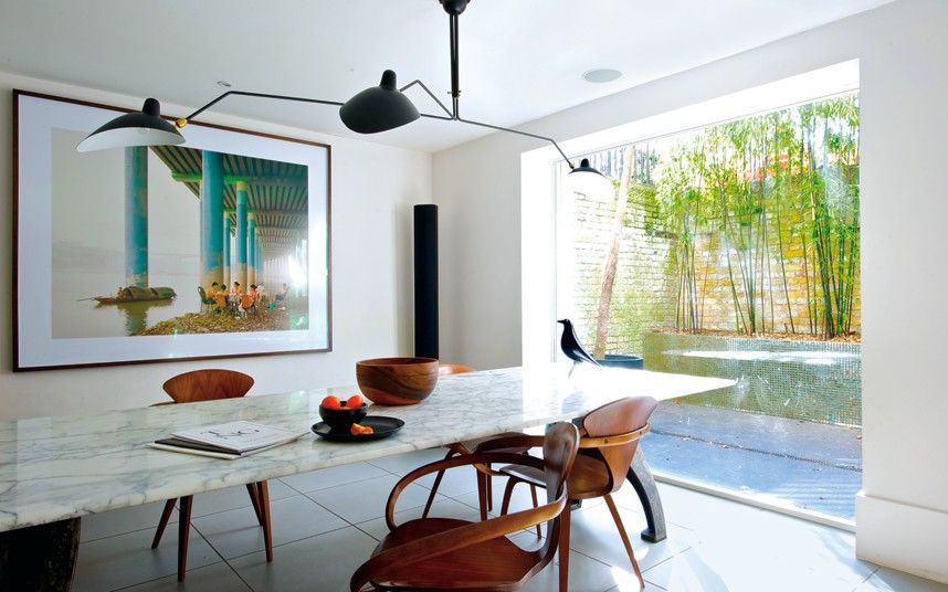 A London Home With Modern Art At Its Centre Contemporary Dining Room Large Scale Custom Marble Table Light By Serge Mouille All Looking Out