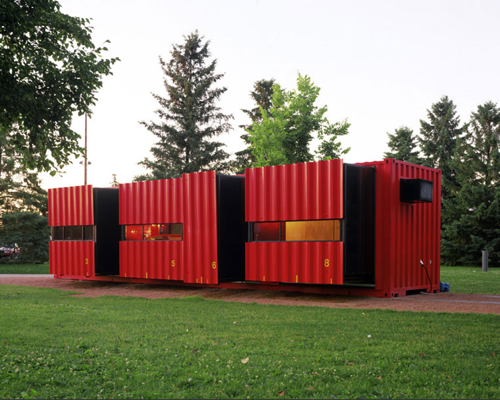 """Many shipping container homes are stacked and linked together to create more living space. That's not the case with the Mobile Dwelling Unit, a proudly single-decker shipping container home that avoids the claustrophobic """"long but narrow"""" syndrome by incorporating pop-out elements that extended from the 40-foot long, 8-foot wide core of the home, accordion-style."""