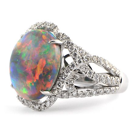 broad flashes of magenta violet neon green and a whole spectrum of colors dance across this carat lightning ridge black opal and diamond ring - Black Opal Wedding Rings