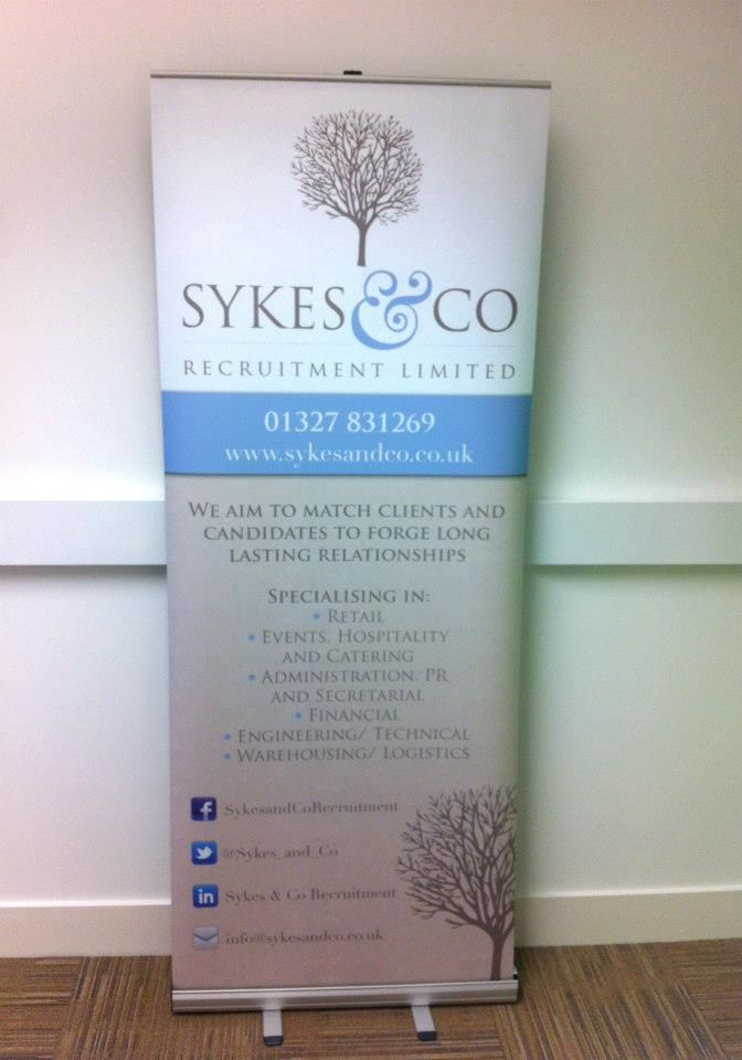 Example Of Vertical Vinyl Banner Stands With Curling Edges - Vertical vinyl banners