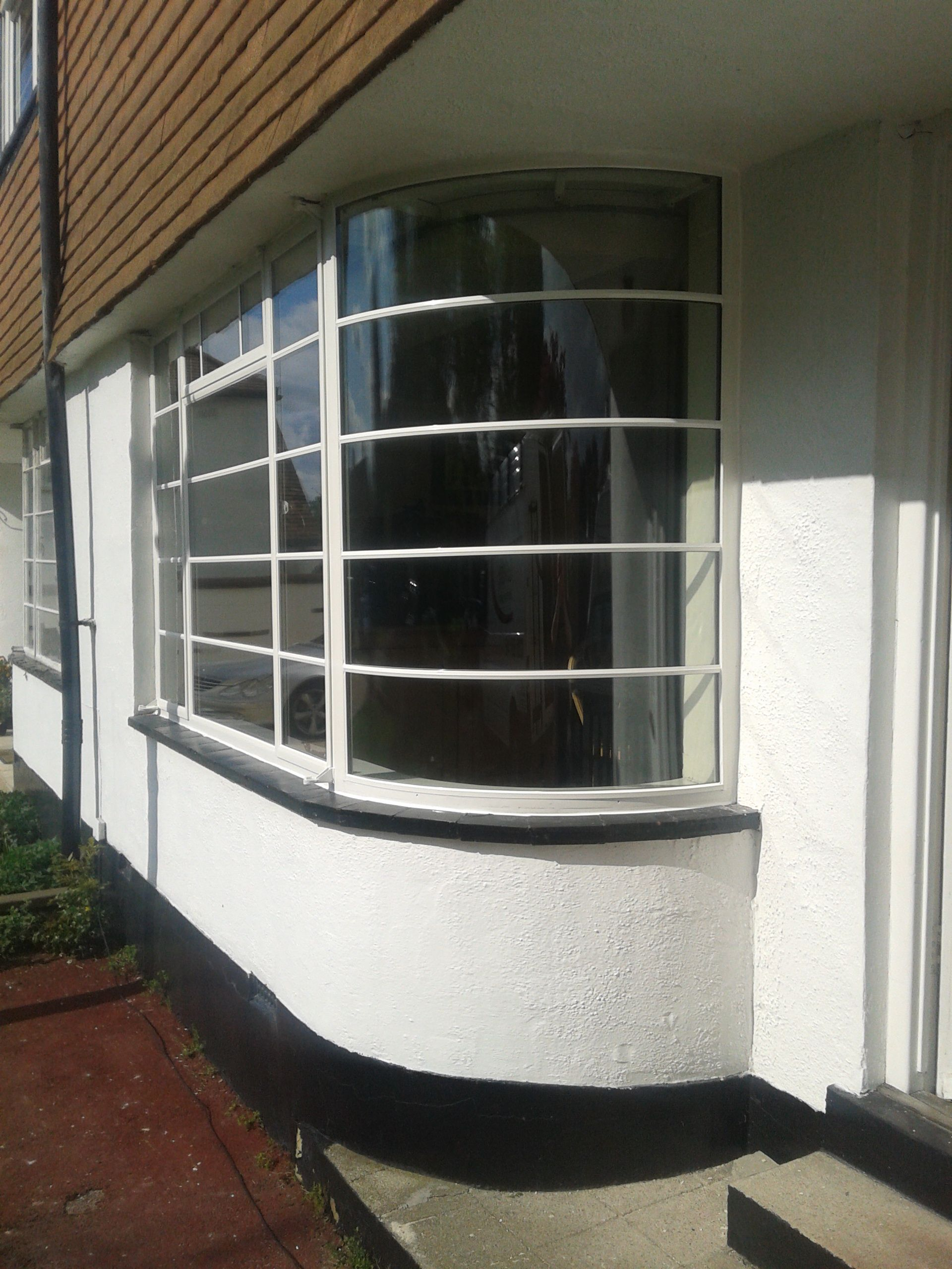 Steel Bay Window With Curved Glass