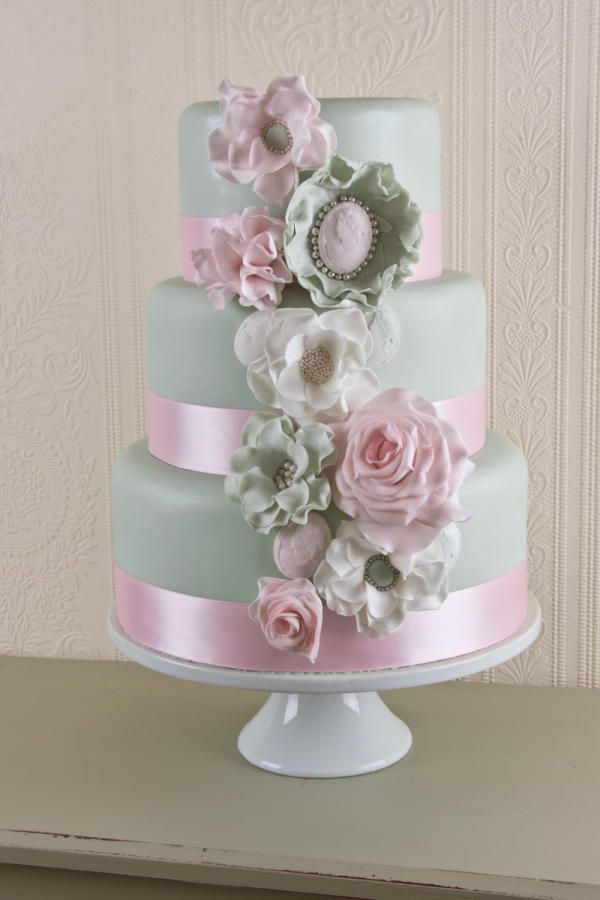 Three tier sugar flower and cameo wedding cake