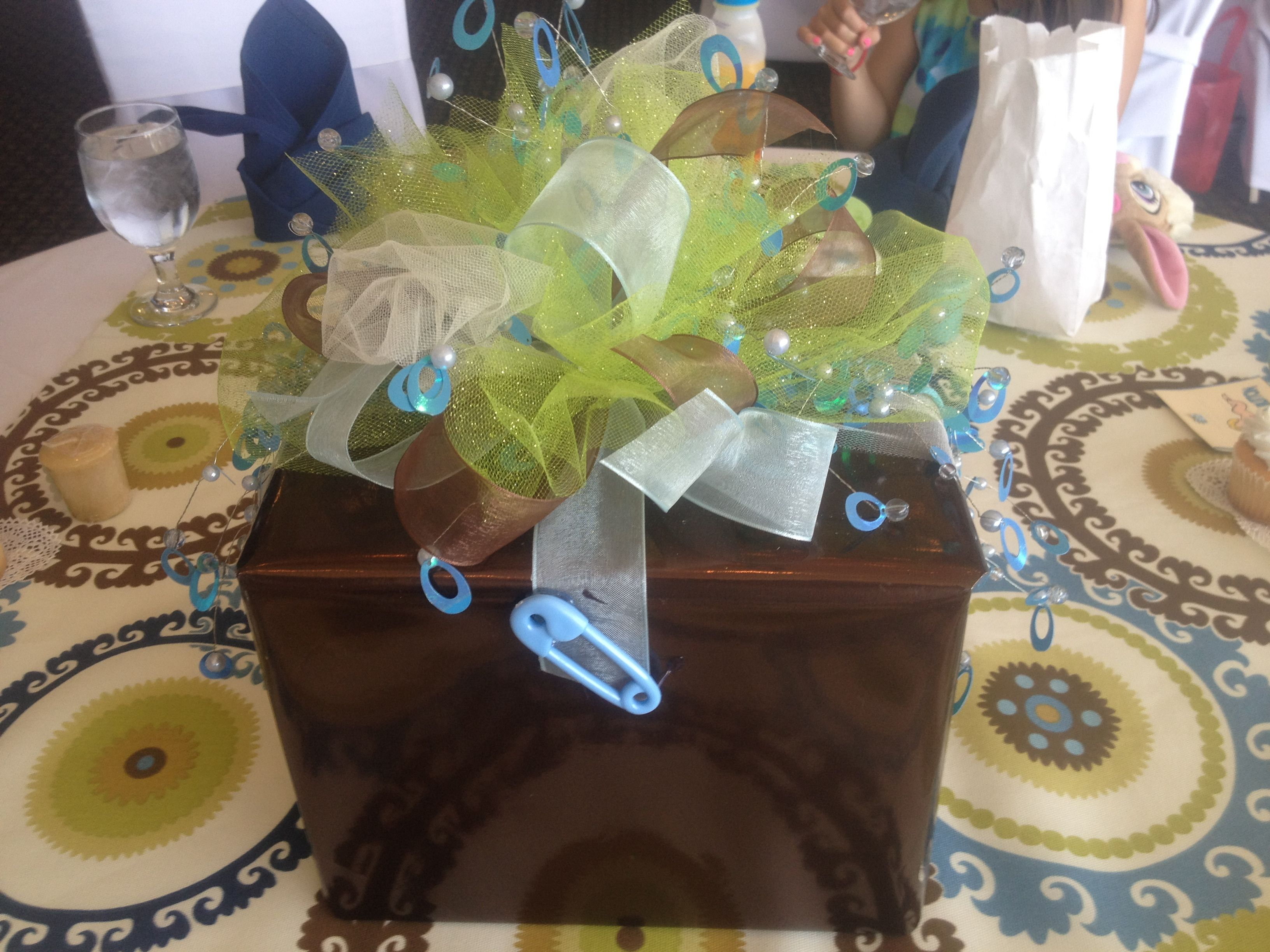 Baby shower centerpieces are boxes of diapers and wipes