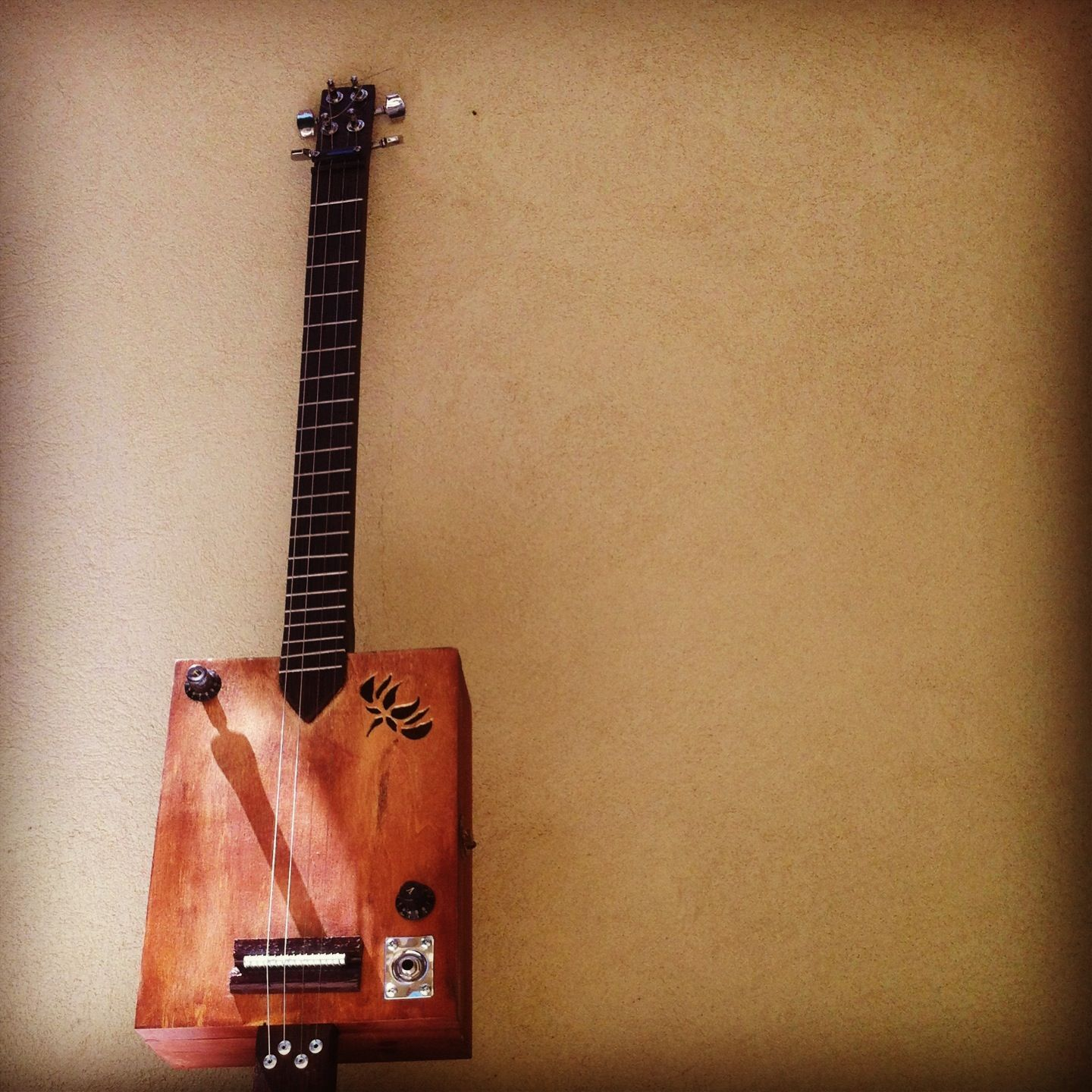cigar box guitar handcarved neck and fret board out of african walnut and a lotus design sound. Black Bedroom Furniture Sets. Home Design Ideas