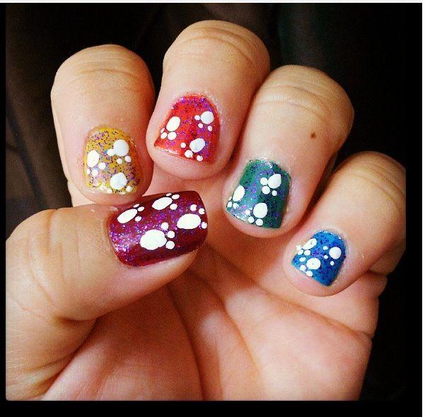 Rainbow Paw print nail design.