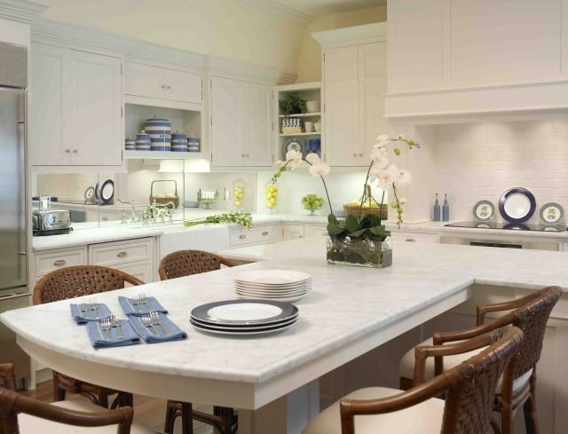 T shaped island white counter tops with an eat at bar This