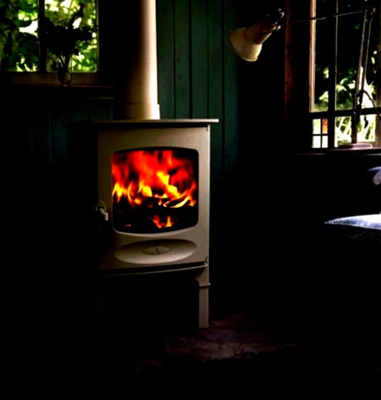 solid fuel stove with an output of 49kw on display within our s A small wood or solid fuel stove with an output of 49kw on display within our s A small wood or solid fuel...