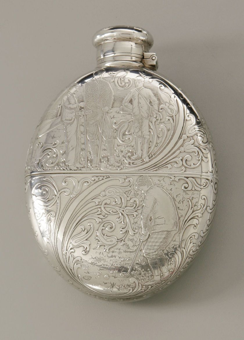 Tiffany & Co., New York, NY, Late Nineteenth Century. The sterling silver flask depicting Golfing Scenes