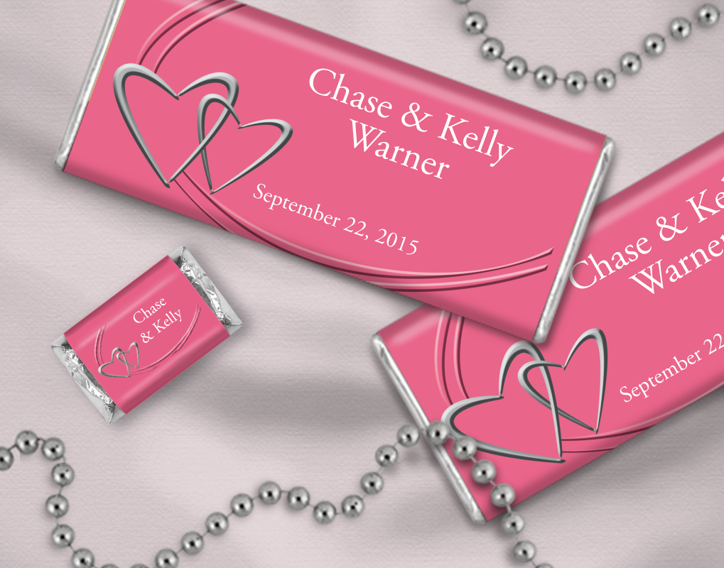 Blush pink personalized candy wrappers adorned with pewter hearts ...