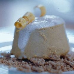 Frozen Pumpkin Flan with Cinnamon Foam and a Nutmeg Crust, a raw vegan dessert treat.