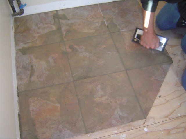 When grouting over corners run the grout float at a 45 degree angle ...