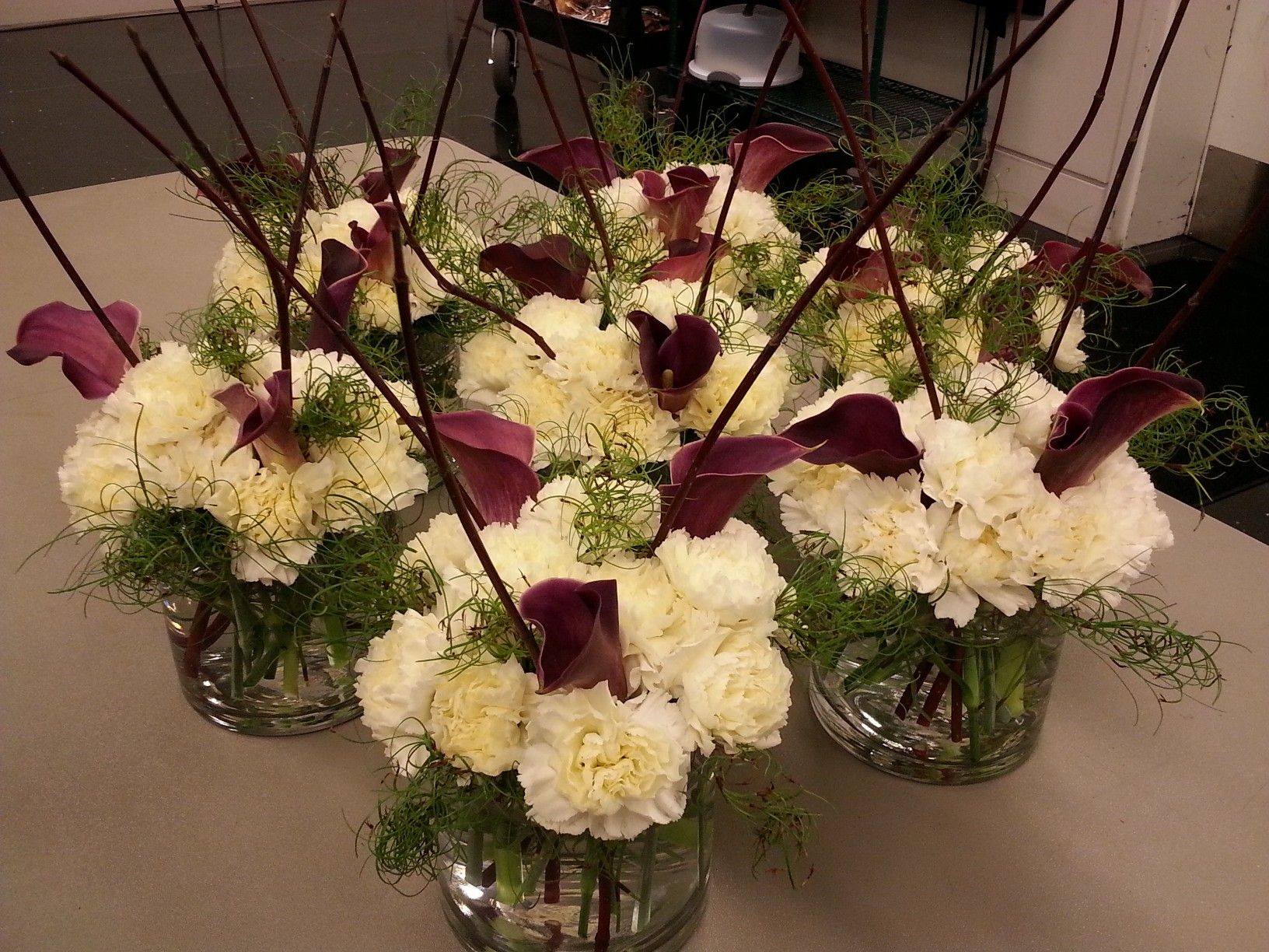 White burgundy floral centerpieces flowers by supper