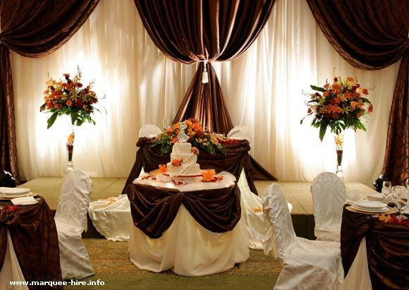 I love Orange and Brown together :) perfect reception hall decore ...