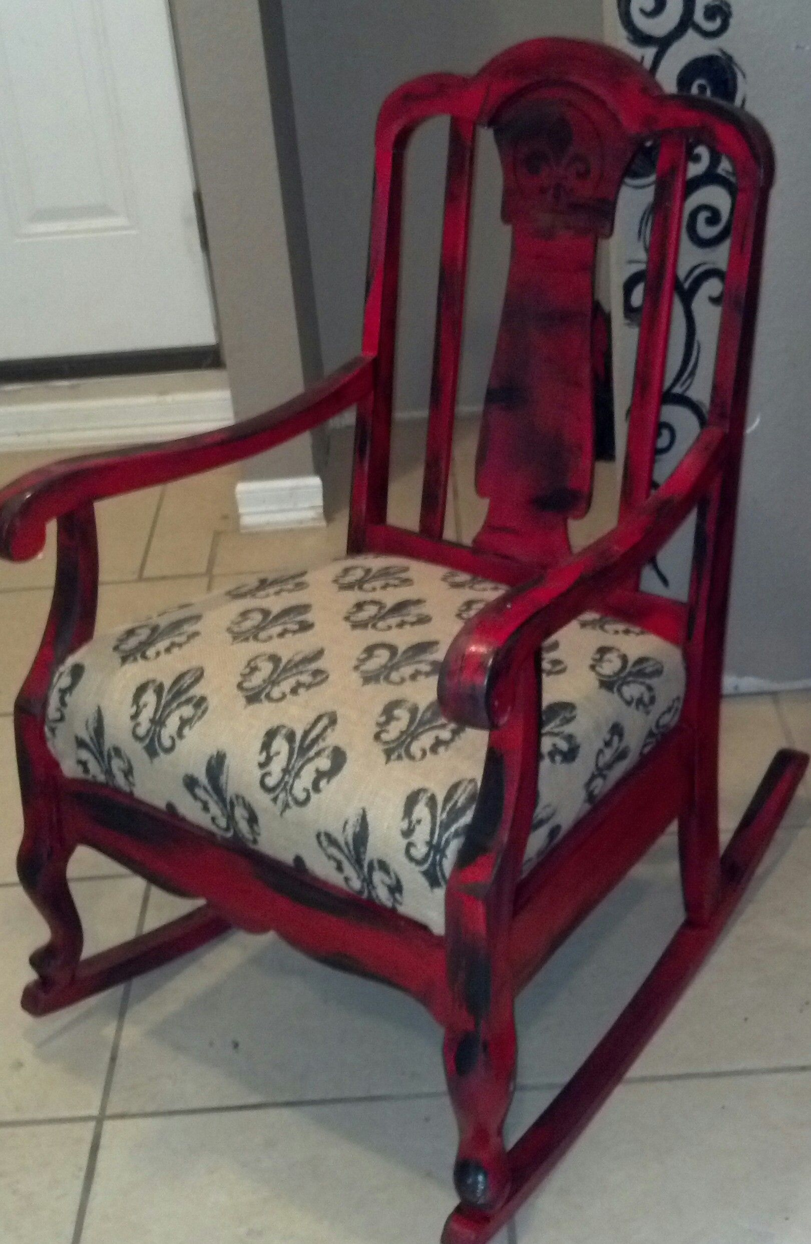 really old rocking chair done in vintage red
