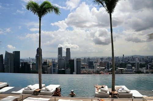 Get a massage at the infinite pool at the Marina Bay Sands Hotel in Singapore.
