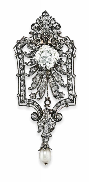 A LATE 19TH CENTURY PEARL AND DIAMOND PENDANT / BROOCH Of shield outline, the central old-cut cushion shaped diamond weighing approximately 9.12 carats, to an old-cut diamond-set fan like surround and outer border, with similarly-set scrolling surmount and terminal suspending a pearl drop, mounted in silver and gold, 8.4cm long, brooch fitting and three small diamonds deficient