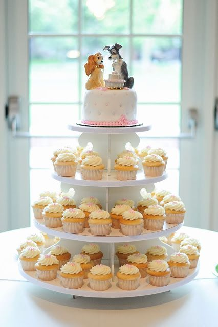 Our wedding cupcake cake! With Lady and the Tramp cake toppers as well! (cake toppers by Lenox)