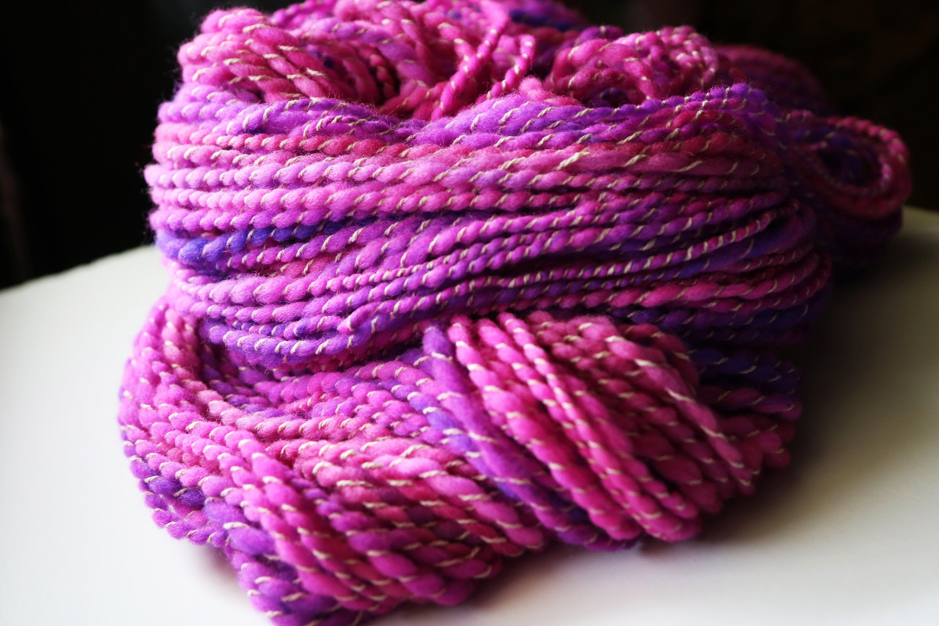 80 Yds Pink and Purple Handspun Yarn Plied with White #crochet #SoftYarn #JewelTone #QualityYarn #HandspunYarn #HandmadeYarn #colorful #ArtYarn #HandDyed #knitting