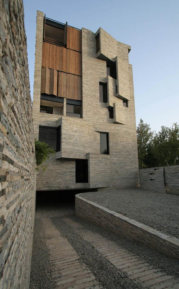 Apartment No.1 in Mahallat, Iran designed by AbCT.  Built from re-cycled local stone.
