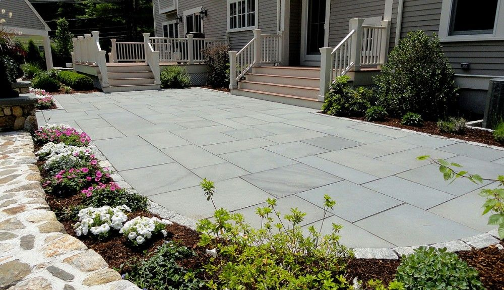PA Thermal Bluestone tile with chestnut deck, white trim, and taupe ...