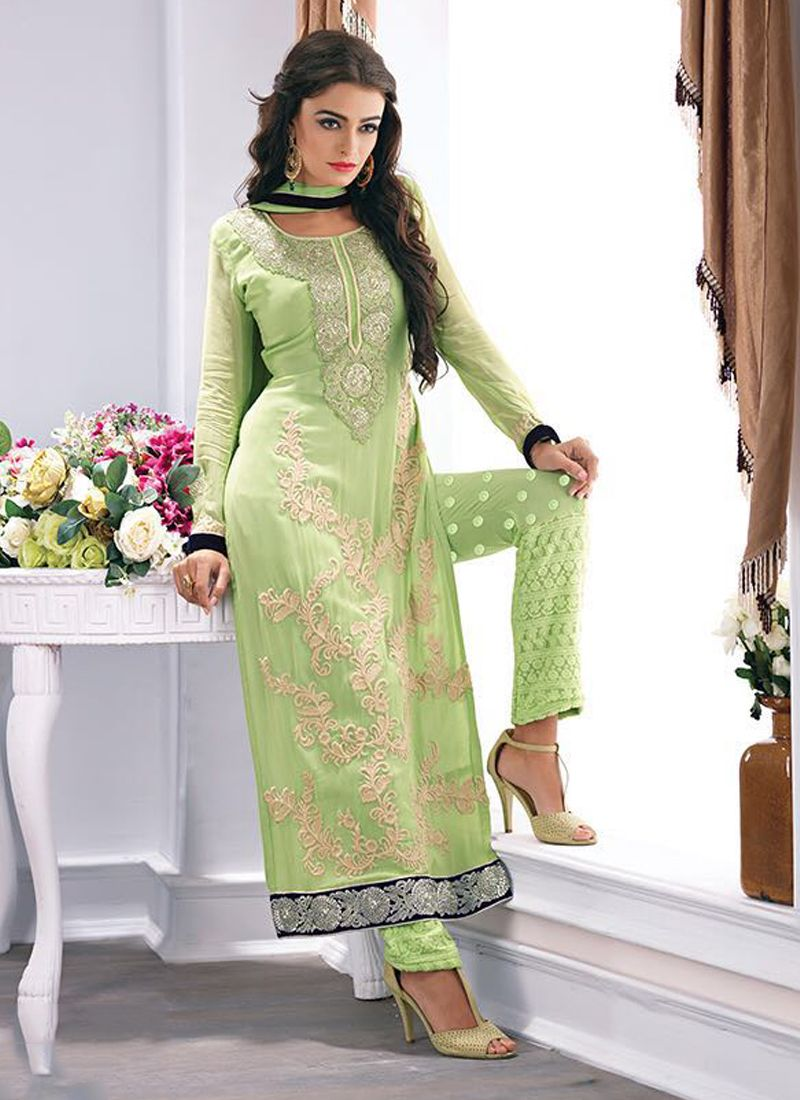 27077fc497 Featuring Pista green embellished pant suit intricately designed with  floral embroidery. It is paired with