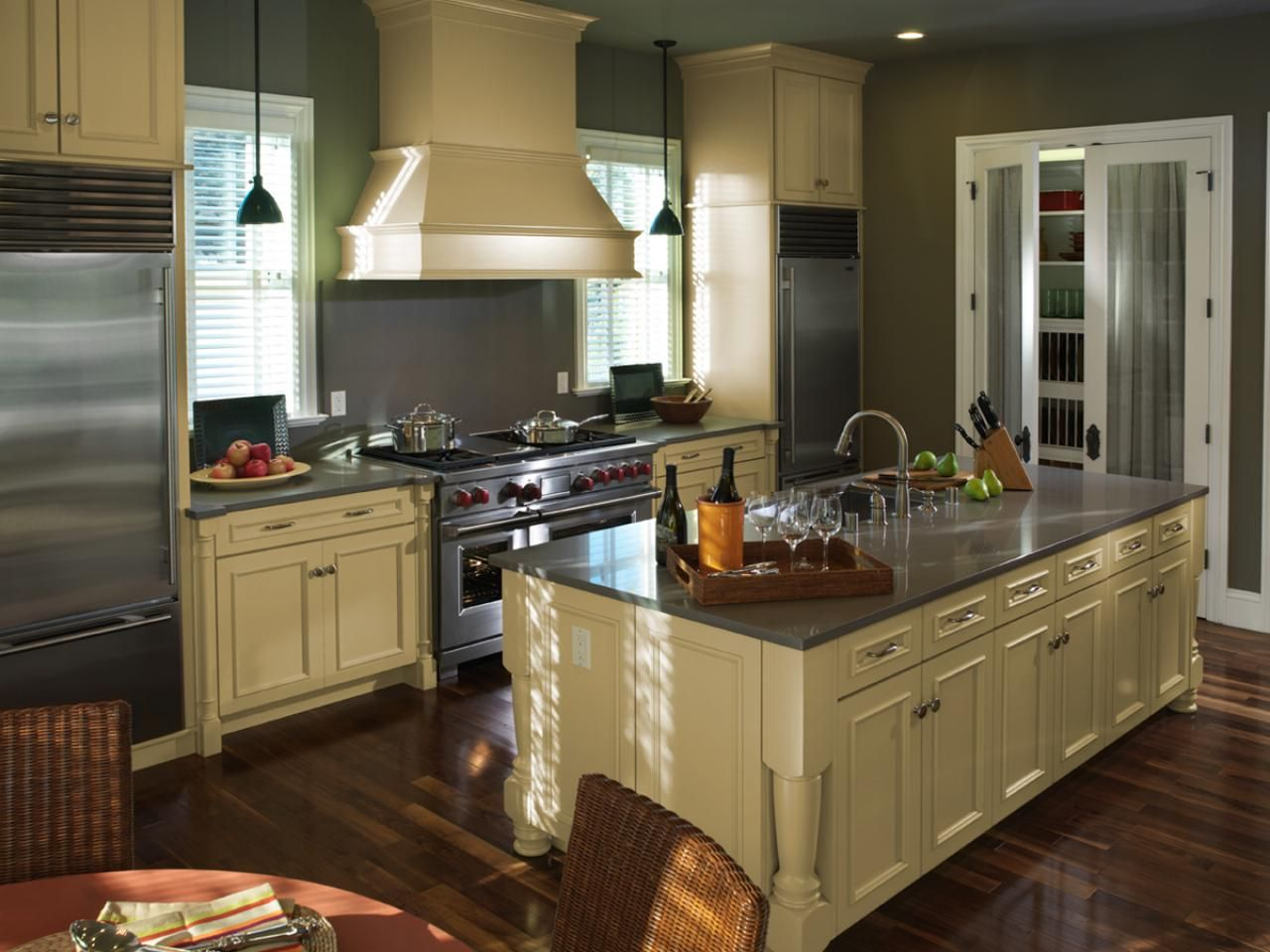 Dove Gray Walls And Cream Cabinets And Stove Hood Elegantly Blend Together  In This Gourmet Kitchen