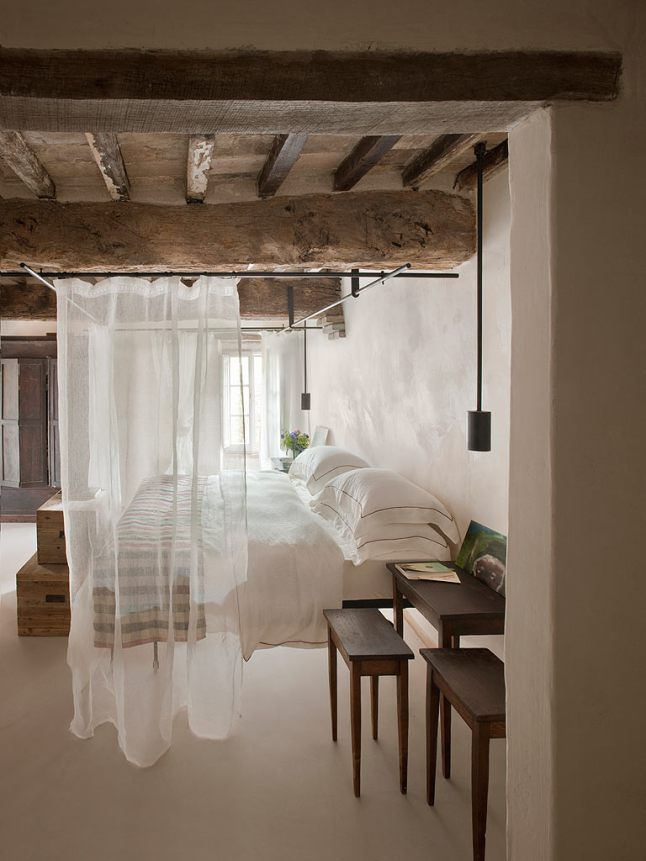 tuscan bedroom with stone walls exposed ceiling beams interior design decorating ideas - Rustic Hotel Decorating