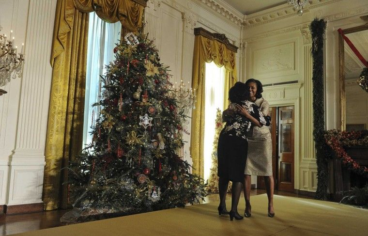 First Lady Michelle Hugs A Volunteer While Presenting The Holiday House Decorationsholiday